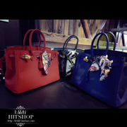 on the conduct of the European station 2014 autumn new women's leather laptop handle Korean wild ladies scarves and bags